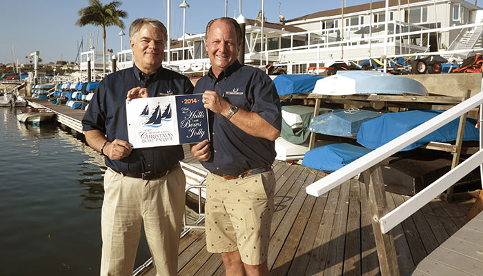America's longest running lighted Christmas boat parade in Newport Beach, California honors boaters with commemorative burgee and plaque